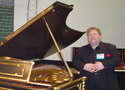 Robby Stand Next To a Million Dollar Piano at Namm